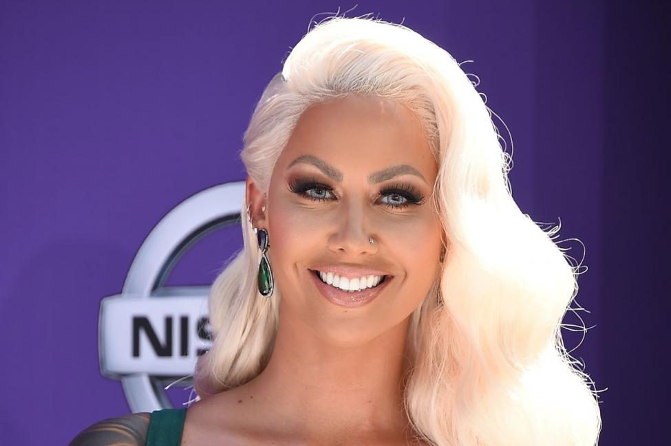 Smiling Amber Rose with long platinum blonde hair