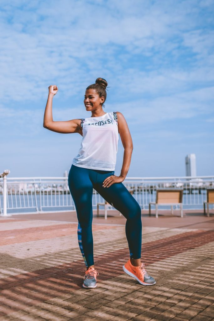 woman fit showing arm muscles